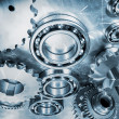 Gears, cogs and bearings in blue — Stock Photo