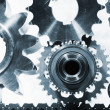 Gears and cogwheels, titanium and steel — Stock Photo #34933523