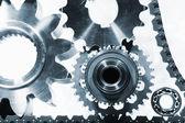 Gears and cogwheels, titanium and steel — Stock Photo