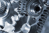 Gears and cogwheels, titanium and steel — Stock Photo
