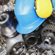 Stock Photo: Hardhat, engineering parts, gears and cogs