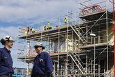 Site workers and construction industry — Stock Photo