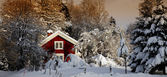 Small cottages set in a rural old winter landscape — Stock Photo
