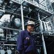 Stock Photo: Oil and gas workers and large refinery industry