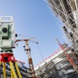 Постер, плакат: Surveyors measuring instrument in action