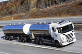 Large fueltruck in motion — Stock Photo