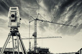 Surveying measuring instrument inside construction industry — Stock Photo