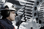 Steel engineer and giant gear machinery — Stock Photo