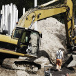 Digger and site worker in action — Stock Photo #47060307