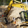 Bulldozer, road-works and site workers in action — Stock Photo #47060333