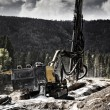 Постер, плакат: Industrial rock blasting machines with surveying instrument
