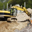 Постер, плакат: Bulldozer road works and site workers in action