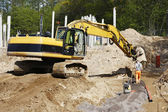 Bulldozer, road-works and site workers in action — Stock Photo