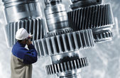 Worker with large gears — Stock Photo