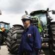 Giant farming tractors and mechanics — Stock Photo #49562815