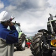 Giant farming tractors and mechanics — Stock Photo #49564929