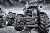 Giant farming tractors and tires — Stock Photo
