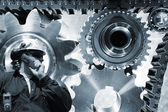 Engineer with large titanium gears machinery — Stock Photo