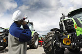 Giant farming tractors and mechanics — Stock Photo