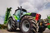 Giant tractor, tires and plow — Stock Photo