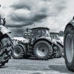 Постер, плакат: Farming tractors on a line up