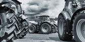 Farming tractors on a line-up — Stock Photo