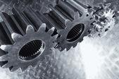 Titanium and steel power cogwheels — Stock Photo