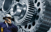 Engineer and cogwheels machinery — Stock Photo