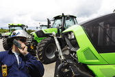 Mechanic and farming tractor line-ups — Stock Photo