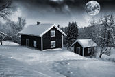 Lonely small cottages draped in winter and snow — Stock Photo