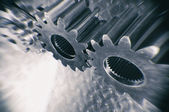 Titanium and steel gears in motion — Stock Photo