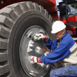 Mechanic and truck tire works — Stock Photo #6419356