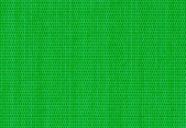 Green background of criss cross fabric texture — Stock Photo