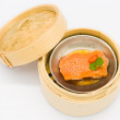 Chinese steamed dim sum salmon fish in bamboo container traditio — Stock Photo