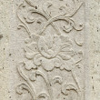 Old stone carving background on temple fence wall — Stock Photo