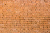 Red color of decorative laterite stone wall surface — Stockfoto