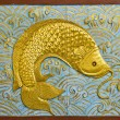 Stock Photo: Fish carve gold paint