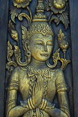 Buddha carved gold paint — Photo