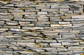 Pattern of decorative slate stone wall — Stock Photo