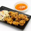 Stock Photo: Fried chicken in black plate with sauce