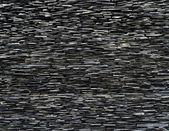 Pattern of decorative slate stone wall — Stock Photo