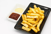 French fries in black plate — Stock Photo