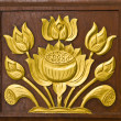 Lotus carved gold paint — Stock Photo