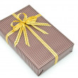 Black gift box with white bar attached gold ribbon — Stock Photo #35197549