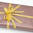 Black gift box with white bar attached gold ribbon — Stock Photo #35199531