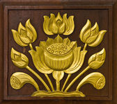 Lotus carved gold paint — Stock fotografie