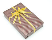 Black gift box with white bar attached gold ribbon — Stock Photo