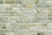 Pattern of green slate stone wall surface — Stock Photo