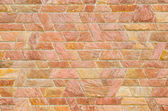 Pattern of red slate stone wall surface — Stock Photo