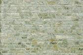 Pattern of green slate stone wall surface — Stock Photo